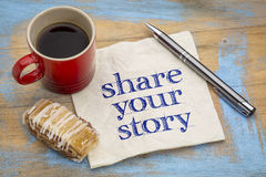 Share your story - napkin concept. Share your story- handwriting on a napkin with a cup of espresso coffee and cookie against grunge painted wood Stock Photos