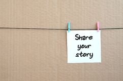 Share your story. Note is written on a white sticker that hangs royalty free stock images