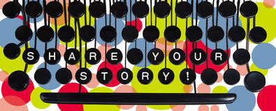 Share  your story! on old keyboard Royalty Free Stock Photos