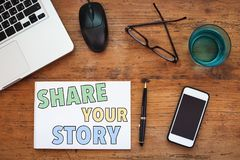 Share your story. Text written on paper, concept Royalty Free Stock Images