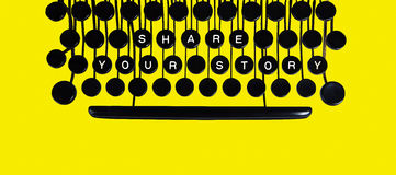Share your story on yellow. Share your story spelled on a vintage keyboard on yellow Stock Photo
