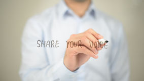 Share Your Voice, man writing on transparent screen Royalty Free Stock Photo