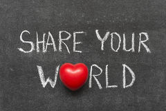 Share your world. Phrase handwritten on blackboard with heart symbol instead of O royalty free stock photos