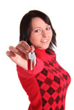 Shared apartment. A young handsome woman handovers some keys. All isolated on white background Stock Photos