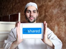 4shared online file sharing and storage logo. Logo of 4shared online file sharing and storage on samsung tablet holded by arab muslim man royalty free stock photography