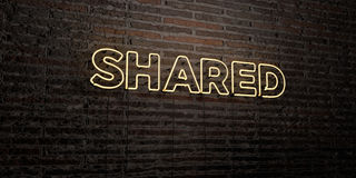SHARED -Realistic Neon Sign on Brick Wall background - 3D rendered royalty free stock image. Can be used for online banner ads and direct mailers Stock Photo