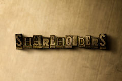 SHAREHOLDERS - close-up of grungy vintage typeset word on metal backdrop Stock Photos