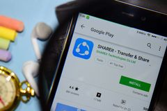 SHAREit - Transfer & Share dev app with magnifying on Smartphone screen. BEKASI, WEST JAVA, INDONESIA. DECEMBER 25, 2018 : SHAREit - Transfer & Share dev app stock image