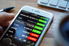 Shares App Displaying Stock Prices on an Apple iPhone 6 Royalty Free Stock Photo