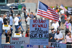 Sharia Protest. People holding signs at a pro-Muslim rally and march in New York City Royalty Free Stock Photo