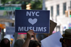 Sharia Protest. People holding signs at a pro-Muslim rally and march in New York City Royalty Free Stock Images