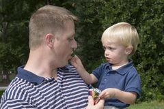 Sharing. Father and son sharing a treat Stock Image