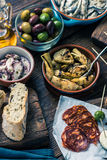 Sharing authentic spanish tapas with friends in bar Royalty Free Stock Photography