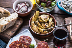 Sharing authentic spanish tapas with friends in bar. Sharing authentic spanish tapas with friends in restaurant or bar. View from above Royalty Free Stock Image