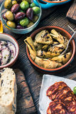 Sharing authentic spanish tapas with friends in bar Royalty Free Stock Photo