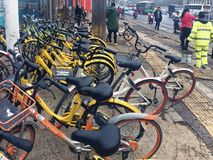 Sharing bicycles in China. Sharing bicycles is a shared bicycle service provided by businesses on campus, subway stations, bus stops, residential areas, business Royalty Free Stock Photo