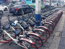 Sharing bicycles in China. Sharing bicycles is a shared bicycle service provided by businesses on campus, subway stations, bus stops, residential areas, business Royalty Free Stock Images