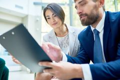 Sharing Business Ideas with Coworker Stock Photo