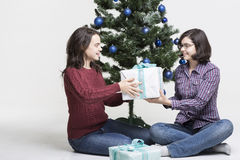 Sharing Christmas gifts Stock Photos