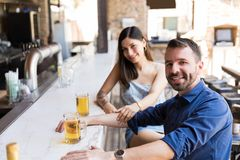 Sharing Drinks And Smile royalty free stock photos
