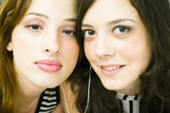 Sharing earphones Royalty Free Stock Images