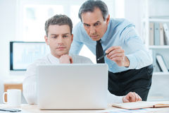 Sharing experience with colleague. Royalty Free Stock Image