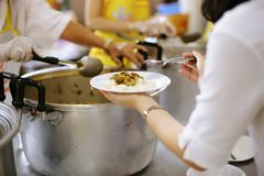 Sharing food with people in poor communities : The concept of feeding.  stock photos
