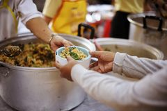 Sharing food with people in poor communities : The concept of feeding.  royalty free stock images