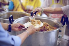 Sharing food with people in poor communities : The concept of feeding.  royalty free stock image