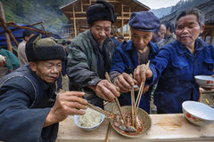 Sharing food at village festival, villagers celebrate beginning Royalty Free Stock Photography