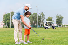 Sharing with golf experience. Royalty Free Stock Photography