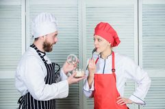 Sharing good time. secret ingredient by recipe. cook uniform. Menu planning. culinary cuisine. Family cooking in kitchen. Couple in love with perfect food. men royalty free stock image