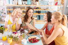Dark-haired woman sharing her happiness with her friends stock photography