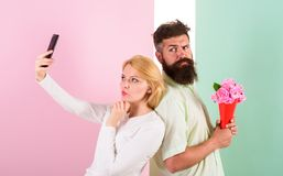 Sharing happy selfie. Woman capturing happy moment boyfriend bring bouquet flowers. Capturing moment to memorize. Taking. Selfie photo. Couple in love bouquet Stock Photography