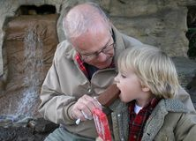 Sharing an Ice Cream Bar with Grandpa stock photography