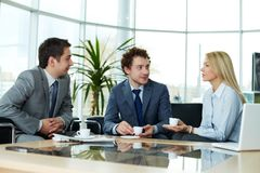 Sharing ideas. Business team sharing ideas during break Stock Image