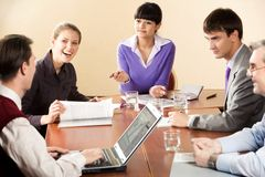 Sharing ideas. Portrait of successful business partners interacting during briefing in office royalty free stock photo