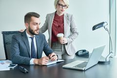 Sharing Ideas with Colleague Royalty Free Stock Image