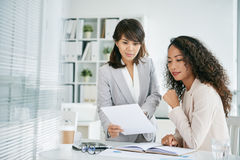 Sharing Ideas with Coworker Stock Photo