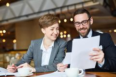 Sharing Ideas with Coworker Royalty Free Stock Photo
