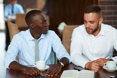 Sharing Ideas with Coworker Stock Image