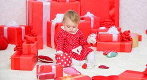 Sharing joy of baby first christmas with family. Baby first christmas once in lifetime event. Gifts for child first. Christmas. Little baby play near pile of stock images