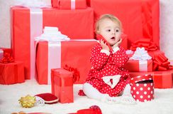 Sharing joy of baby first christmas with family. Little baby girl play near pile of gift boxes. Gifts for child first. Christmas. Celebrate first christmas royalty free stock image