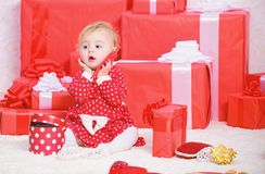 Sharing joy of baby first christmas with family. Little baby girl play near pile of gift boxes. Gifts for child first. Christmas. Celebrate first christmas royalty free stock photos