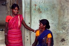Sharing light moments. Two tribal women sharing light moments in front of their house at Amaridanga, India Stock Photos