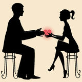 Sharing love. A silhouette of a man and a woman sharing a heart stock illustration