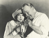 Sharing a milkshake Stock Photography