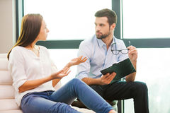 Sharing problems with psychiatrist. Royalty Free Stock Images