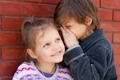 Sharing secrets. Two cute kids sharing a secret Stock Photography