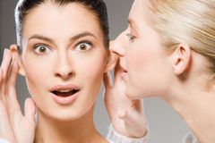 Sharing secrets Stock Images